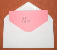 Self-Addressed, Stamped Envelope with a pink Index Card that says No
