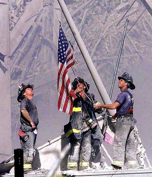 Remembering 9/11/2011 - Heroes raise the Flag at the WTC